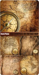Stock Photo: Old compass on vintage map