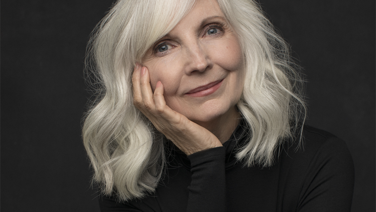 Portrait Of Mature Woman With Short Grey Hair Stock Photo