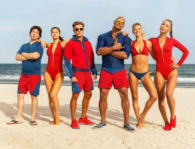 Dwayne Johnson, Zac Efron, Alexandra Daddario, Kelly Rohrbach, Jon Bass and Ilfenesh Hadera on the beach